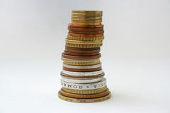 Coins tower. Tower made of different coins Stock Images