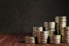 Coins Tower on the Wood Table, Concept picture of Financial stock images