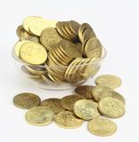 Coins in a transparent plastic container Royalty Free Stock Photos