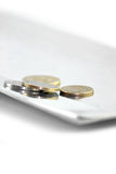 Coins on a tray - close up Stock Photo