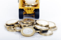 Coins and truck Royalty Free Stock Images