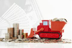 Coins in truck toy for money saving financial concept.  Saving m Royalty Free Stock Photos