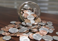 Coins tumbling from Jar 2 Royalty Free Stock Image