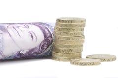 Coins and Twenty pound note Stock Photos