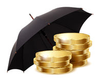 Coins under a black umbrella Stock Photo