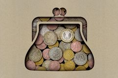 Coins under a sheet of paper with a cut out purse stock photography