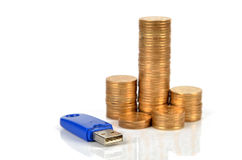 Coins and USB disk stock photo