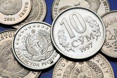 Coins of Uzbekistan. State emblem of Uzbekistan depicted in the Uzbekistani som coins and the Uzbekistani 10 som coin Royalty Free Stock Photography
