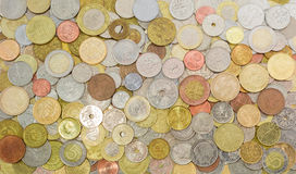 Coins from various countries in circulation at different times Stock Photos