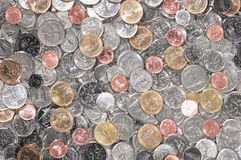 Coins. Various currency coins scattered on floor Stock Images