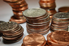 Coins. Various coins stacked. From pennies to dimes and quarters stock photography