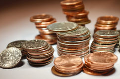 Coins. Various coins stacked. From pennies to dimes and quarters royalty free stock photography