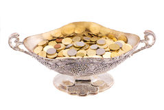 Coins in a vase. Money of the different countries the isolated combined in a brilliant vase Royalty Free Stock Photography