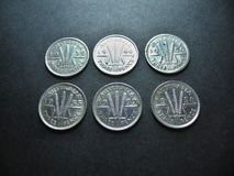 Coins Vintage Silver Australian Threepence. Six Australian silver vintage threepence coins. The reverse shows a sheaf of wheat with three stems tied in a ribbon Royalty Free Stock Photos