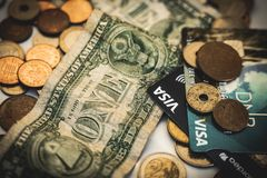Coins, visa and dollar bills, money concept stock image