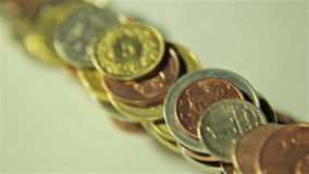 Coins wall on the table. Slider, close up shot stock footage