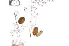 Coins in water Stock Photo