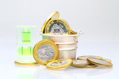 Coins with water level Royalty Free Stock Photo