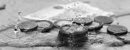 Coins and water splashes, business object Royalty Free Stock Image