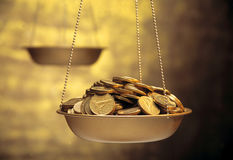 Coins on weighing machine Stock Image