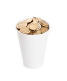 Coins in a white cup  on white Stock Photography