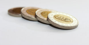 Coins on white. Some piece of hungarian coins are isolated on white stock image