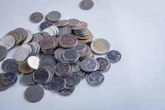 Coins on white table.jpg Stock Image