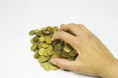 Coins and woman hand Royalty Free Stock Image