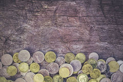 Coins on the wood Stock Image