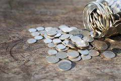 Coins on the wood. Coins on the wood with jar or glass. financial concept. top view Stock Photography