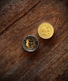 Coins on a wooden background Royalty Free Stock Image