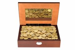 Coins in a wooden casket Stock Photos