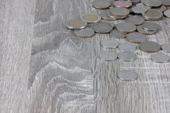 Coins are on the wooden gray table stock photography