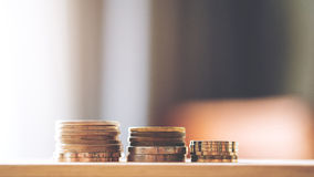 Coins on wooden table Royalty Free Stock Photography