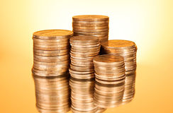 Coins on yellow background Royalty Free Stock Photo