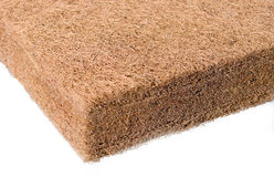 Coir or Coconut Husk Fiber. Brown coir is a fiber processed from coconut husks and used for mats, brushes, insulation and upholstery padding Stock Images