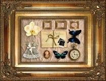Coisas do vintage no frame dourado Foto de Stock Royalty Free