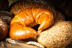 Coissant, bread and buns. On wooden table Royalty Free Stock Image