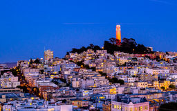 Coit tower and houses on the hill san francisco at night Stock Images