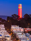 Coit Tower in Red and Gold. Coit Tower lit up in red and gold in honor of the San Francisco 49ers hosting a 2013 NFL playoff game Royalty Free Stock Images