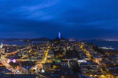 Coit Tower San Francisco Night. San Francisco, California, USA - April 23, 2016 - Coit Tower, San Francisco Bay and the North Beach community at dusk Royalty Free Stock Photography