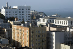 Coit Tower SF Skyline. Coit Tower rises above the cities buildings royalty free stock image