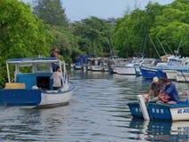 Cojimar river / Rio de Cojimar. Boats and fishermen on the Cojimar river / Botes y Embarcaciones en el rio de Cojimar stock image