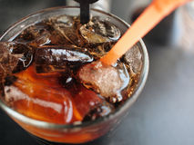 Coke. Chilled glass of coke with lemon Stock Photo