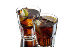 Coke. Two glasses of coke with a wedge of lime Royalty Free Stock Image