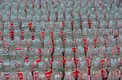 Coke Bottles Lined Up for Ring Toss Stock Images