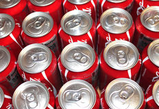 Coke Cans With Pop Tops. Several Coke Cans Lined Up And In A Row stock images
