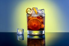 Coke cocktail with ice and lemon, alcohol bar.  royalty free stock images