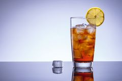 Coke cocktail with ice and lemon, alcohol bar.  stock photo