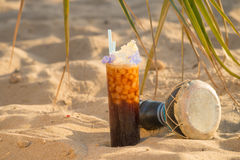 Coke cocktail on the sand. Coke cocktail still life on  a sunny beach Stock Image